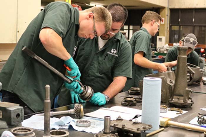auto tech students working with auto parts